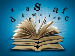 11419177-el-libro-magico-y-las-letras-sobre-un-fondo-oscuro-con-la-formula-concepto-de-educacion-300x226
